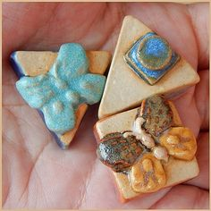 Set consists of 3 beads, 2 triangular and 1 square…