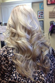 Blonde, layers, and big curls :)