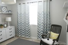 Gorgeous nursery with ombre chevron curtains. #chevron #ombre #nursery..love the acorn garland, felt and fabric pennant banner, wood wall, colors- everything!