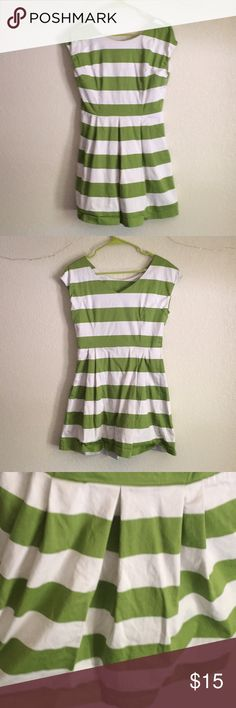 """Green and White Striped Dress This dress is so cute on a warm summer day paired with some flats!  32 1/2 inches from top of the shoulder to bottom 14 1/2 inches across the waist I am 5'7"""" and the dress comes to about 3 inches above my knee  The flaps of fabric at the top that are beneath the collar like to wrinkle up a bit which can be ironed out. Slight coffee stain on the front, and the zipper (hidden on the left side) likes to stop moving about 1/2 an inch from the top, pictures of these…"""
