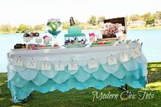 What a great idea for the table cloth at a beach baby shower!