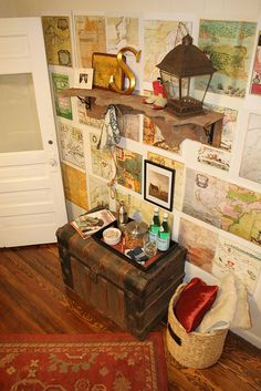 Maps on the wall, old trunk and lantern, amazing shelf. All around awesome.