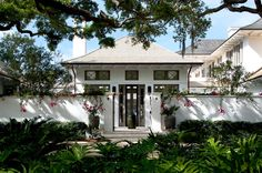 Roofline, shake, white stucco and warm gray trim and let's not forget the bougainvillea! Clemens Bruns Schaub Architect and Associates