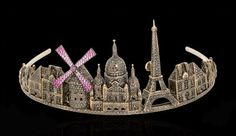 The Paris Tiara by Lydia Courteille with a display of the most famous landmarks including the Eiffel Tower, the Sacre-Coeur and the Moulin Rouge.  Crafted in 18ct black gold, the tiara has been intricately hand set with hundreds of tiny black diamonds and rubies