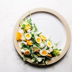 """having a lazy day in bed dreaming of salad with tiny soft boiled quail eggs, orange tomatoes, baby bocconcini, fennel, thinly slice cucumbers and greens…"""