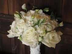 White roses, sweet pea, lisianthus, ranunculus and stephanotis bouquet