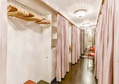 Swooning over this closet. Love the PINK curtains and crystal ceiling light. | Leighton Meester Sells Her Adorable L.A. Bachelorette Pad