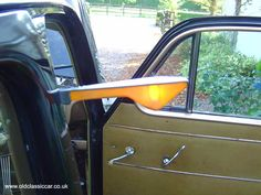 """as a child I remember some cars with the wing indicator.  And door handles such as these, and handles to """"roll down"""" the window"""