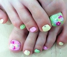 green and pink floral pedicure nail art design