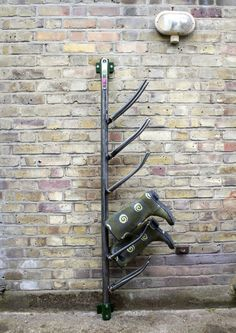 This wellington boot rack was made using multiple bike forks scaffold tube and scaffold fittings. The whole system is able to swivel and is perfect for your hunters