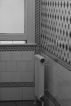 A Victorian tiled bathroom, which is now multi-sexed.