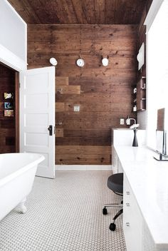White bathroom with wood accent wall