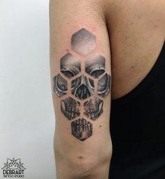 Honeycomb skull tattoo by Deborah Genchi