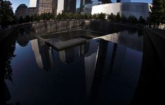 A reflection of One World Trade Center can be seen in the water from the pool at the National September 11 Memorial & Museum at the World Trade Center site in New York.