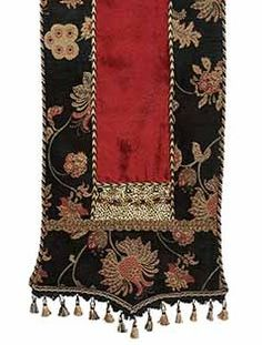 Our Black and red floral chenille Home Decor Table Runner is accented with a touch of velvet cheetah.The table runner is finished off with beads,tassel fringe, and braided trims to give it a look that would add drama to most any room! By Reilly-Chance Collection
