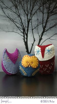 """3 owls, I have to figure out who to make these.  I love the """"snowflake"""" looking eyes on the red one"""