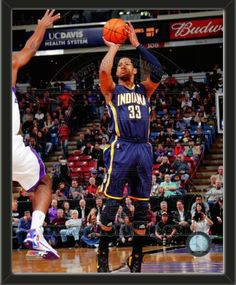 One framed 8 x 10 inch Indiana Pacers photo of Danny Granger.  The photo is textured and comes glassless in a wood frame.  $19.99 @ ArtandMore.com