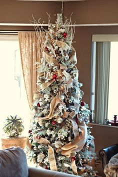 Christmas Decorating Inspiration Rough woven ribbon and frosted branches infused this tree with a bold yet rustic comfort. Rose Gold Christmas Decorations, Ribbon On Christmas Tree, Christmas Swags, Christmas Wrapping, Xmas Tree, Holiday Decor, Holiday Crafts, Merry Christmas, Rustic Christmas