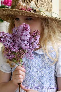 What could be more charming than lilacs & a smocked pinafore?