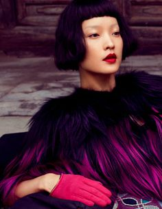 'Enter The Dragon' editorial has Du Juan modeling for Miguel Reveriego #fashion #feathers #purple