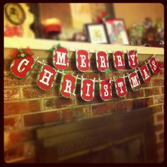 My Christmas banner!!! I love it!! Hand cut shapes with storybook font cricut cut letters... Hung with tiny clothespins from Walmart craft section...