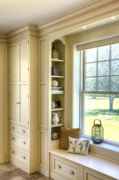 Crown Point Cabinetry - window seat + cupboards
