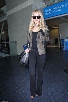 Arriving in style: Rosie Huntington-Whiteley jetted back home to Los Angeles on Friday, following a work trip to New York, showing off a chic casual look