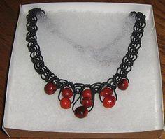 geflochtene schwarze #Halskette mit #Huayruros #Samen