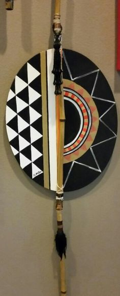 Contemporary African shield, mixed media canvas with bamboo pole and beading.