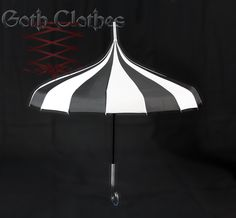This beautiful Black & White Striped Burtonesque Umbrella is the must have accessory for all your wet weather needs.  This would be great dangling over a table. AUD45.00 or $42.00