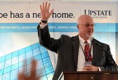 """During the opening ceremony for the new cancer center, John McCabe, CEO of Upstate University Hospital, watched many hands go up when he asked, """" And body in the audience had - have cancer, or been touched by someone with cancer? This building is important to us."""""""
