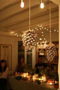 gorgeous décor, Hanging glittered pinecones from the ceiling for the holidays
