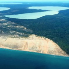 sweet aerial photo of Sleeping Bear Dunes. Credit to the photographer....who's name I didn't catch.