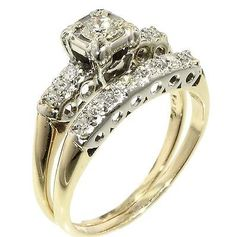 Vintage Antique .27 TCW Round Cut Diamond Engagement Rings  - 14k Yellow Gold11RoundCut Diamonds Gorgeous vintage wedding ring set for her! The vintagedesign will stand the test of time just like your love! 14K YellowGoldRings .17carat center diamond set in raised illusion style head with 4diamonds in the band  Wedding band - 6 diamonds in the band .27total carat weight The diamonds are set in white gold heads, yellow gold engagement & wedding rings