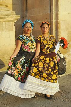 These women were serving mezcal to guests at an upscale wedding at the church of Santo Domingo in Oaxaca, Mexico.  They are wearing the magnificent outfits worn by the Zapotec women from the Isthmus of Tehuantepec.