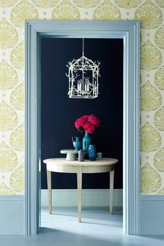 Create an elegant yet restful look for your hallway by layering bold paint colours with pretty pastel printed walls. The wallpaper is 'Lotus' (fennel) by Galbraith & Paul (£124 a metre, at Tissus d'Hélène) while the floorboards and woodwork is painted in 'Constantia Blue', £51.50 for 2.5 litres at Paint & Paper Library.