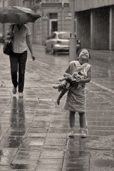 Remember as a child it was thrilling to go out in the rain, one could play in puddles for hours (though not allowed). It's unfortunate that as adults we mostly lose that unadulterated excitement over something so pure and natural as rain. © Peter Przybille