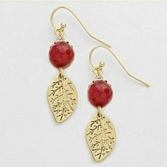 """Gold leaf dangle earrings NWT Sparkling gold tone leaf earrings with a ruby red accent stone. Pierced hook dangle style. 1/2"""". Brand new with tag. Jill Marie Boutique Jewelry Earrings"""