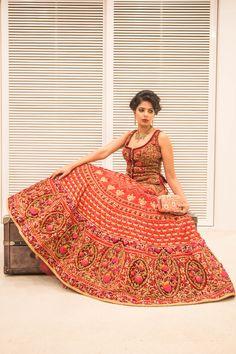 Glamorous, ornate bridal lehenga in red and maroon with corset style blouse #wedmegood