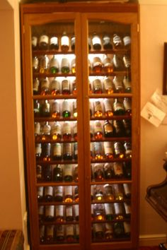 whiskey cabinet, shelf detail.... maybe throw a bottle or 12 of ...