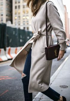 ripped skinny jeans with frayed hem, burgundy red velvet pumps, taupe neutral tie waist and tie sleeve wool robe coat, ivory v-neck sweater, burgundy dylan ysl bag