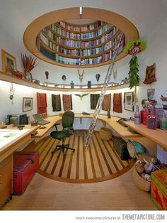 I'd probably spend a lot more time working if my library/office space looked like this...