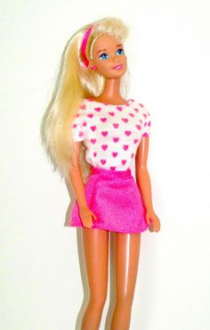 1996 Pretty Hearts Barbie. She was my favorite. This outfit was my favorite too.