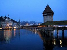 Luzerne,  Switzerland.. Chapel Bridge. Don't walk on it at night . It is full of CRAZY spiders! Totally freaked me out. They come out and drop down on webs at night. Beautiful city, but too many big spiders!