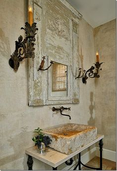 chippy mirror, sconces, stone sink, wall mounted faucet