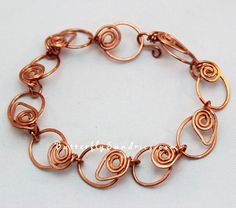 This beautiful and elegant bracelet is the latest addition to my Tendrils of the Vine Collection, original jewelry designs (copyright protected) inspired by the amazing wines of Washington state (personally, I favor the reds). #OOAK Handmade Tendrils of the Vine Link by ButterflySundries, $38.00    #jewelry #bracelet #copper #tendrils #vine #grape #wine #wino #leaf #link #chain #handmade #ooak