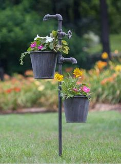 """Give your garden an industrial look with this clever little planter. The spigots give the appearance of the running water to the flowers below. It stands 40½"""" t"""