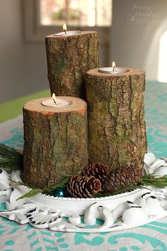DIY Log Candles.   3″ or wider diameter logs cut into 5″, 7″ and a 10″ length  Drill (with extra charged battery)  Sander and sandpaper  Clamps or clamping work table  1″ spade drill bit  1.5″ spade drill bit