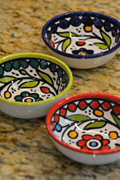 West Bank Dipping Bowls Our sweet West Bank Dipping Bowls made a beautiful addition to a table. A great size to use for salt, spices or olive oil. Available in four colors and hand painted in traditional Palestinian motifs, you will adore these Fair Trade Ceramic Cafe, Ceramic Mugs, Ceramic Bowls, Ceramic Pottery, Painted Clay Pots, Hand Painted Ceramics, Slab Ceramics, Pottery Painting Designs, Mexican Ceramics