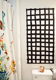 DIY graphic art - love the entire bathroom with its mix of black and white graphic patterns with the white walls and colorful floral shower curtain